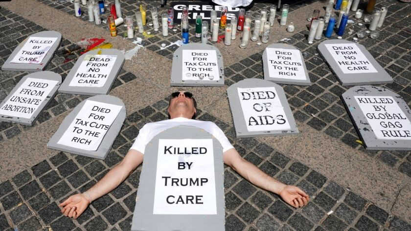 epa06044293 Health care advocates are in the midst of a 24-hour vigil outside of the Trump Internati