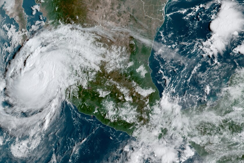 This satellite image provided by the National Oceanic and Atmospheric Administration shows Hurricane Olaf on the Pacific coast of Mexico approaching the Los Cabos resort region at the tip of the Baja California Peninsula, Thursday, Sept. 9, 2021, at 14:30 OZ (10:30am a.m. ET). (NOAA/NESDIS/STAR GOES via AP)