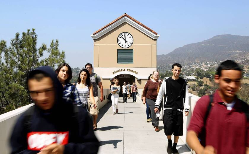 Students walk along a bridge toward a parking structure at Glendale Community College. Thousands of community college classes will be restored, thanks to the passage of Proposition 30.