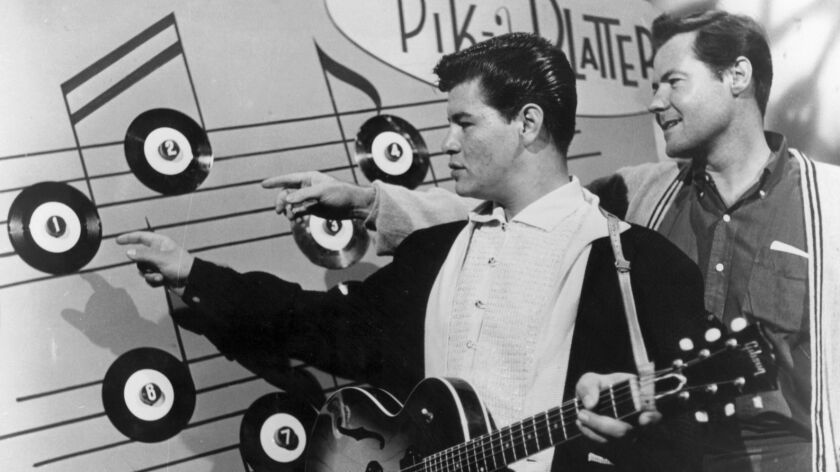 CA.LEWIS2.1213.HO RITCHIE VALENS DURING THE TAPING OF A 1958 TV TEEN DANCE SHOW. AT HIS RIGHT IS HIS