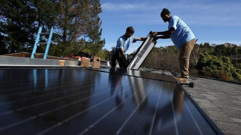 States such as California, Arizona and Nevada have moved to increase fees on homeowners and businesses with solar panels. (AFP / Getty Images)