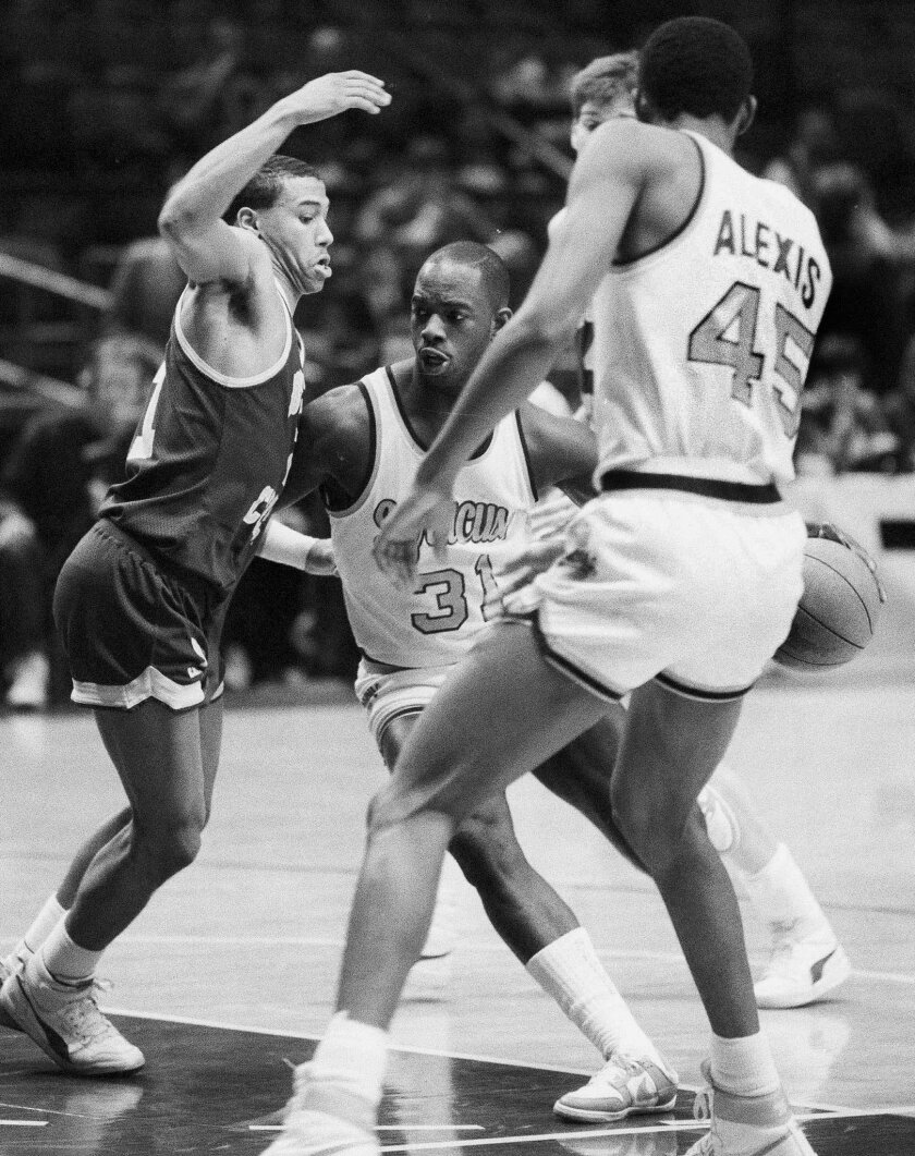 """FILE - In this March 6, 1986 file photo, Dwayne """"Pearl"""" Washington (31) of Syracuse University drives around Dana Barros (21) of Boston College during the Big East tournament at New York's Madison Square Garden. Washington, who went from New York City playground wonder to Big East star for Jim Boeh"""