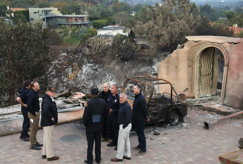 MALIBU, CA ? NOVEMBER 17, 2018 - - President Donald Trump, center, surveys the damage from the Wool