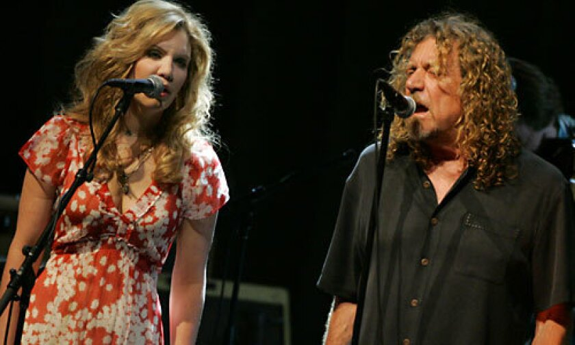 UNLIKELY PAIR: Country-bluegrass star Alison Krauss and rocker Robert Plant at the Greek.