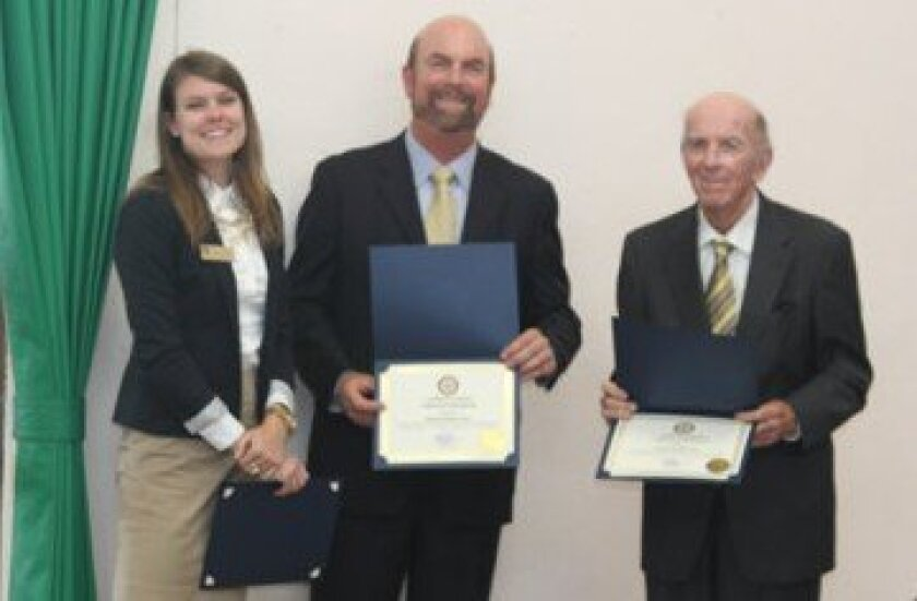 Representing 52nd District Congressmember and La Jolla resident Scott Peters, Sarah Czarnecki presents a certificate of 'special congressional recognition' to Dean and Steve Haskins for the father-and-son duo's service as presidents of the La Jolla Town Council.