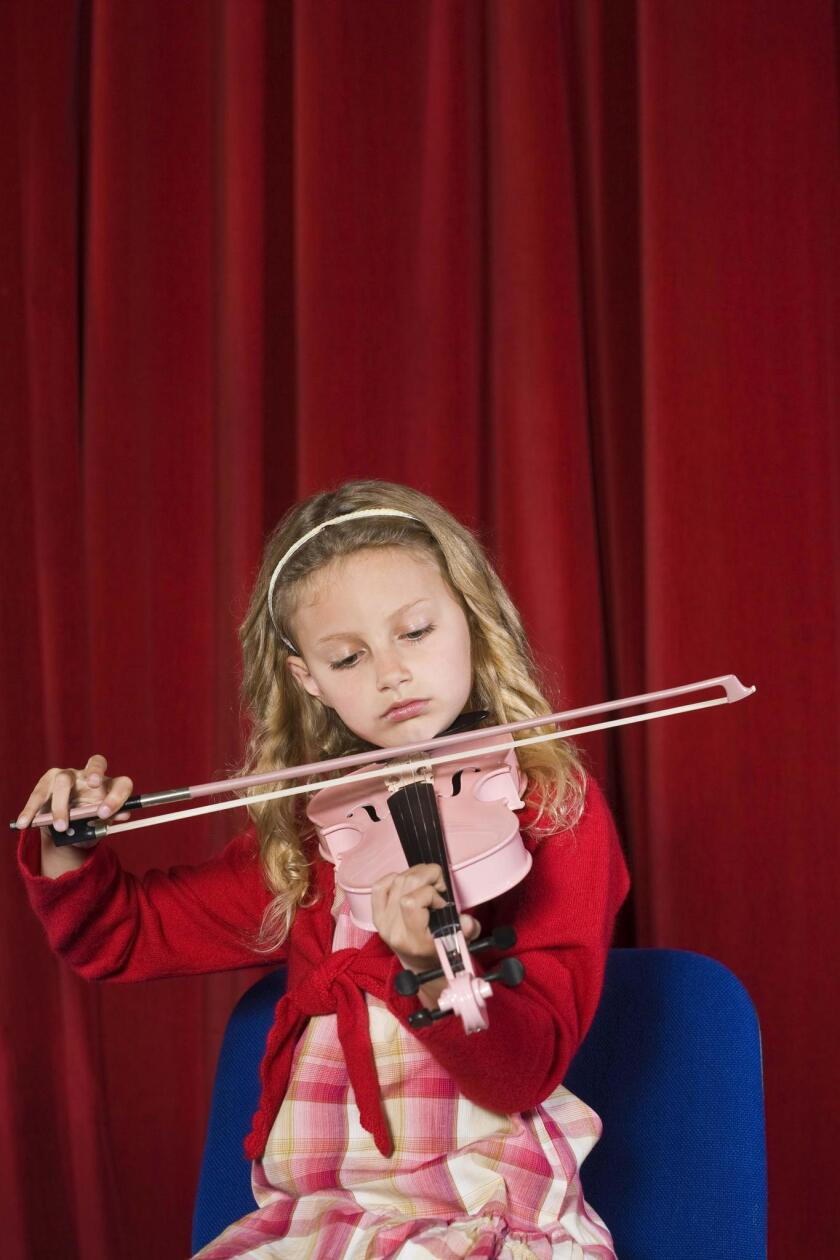 When Minnie appeared with the violin for a 'Christmas concert,' the looks of horror went unnoticed.