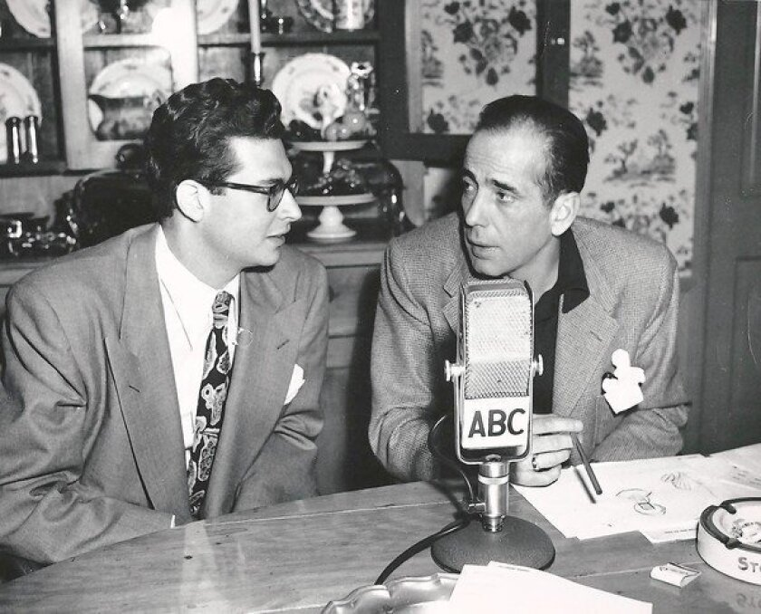 Larry Sloan, left, is pictured with actor Humphrey Bogart in an undated photo.