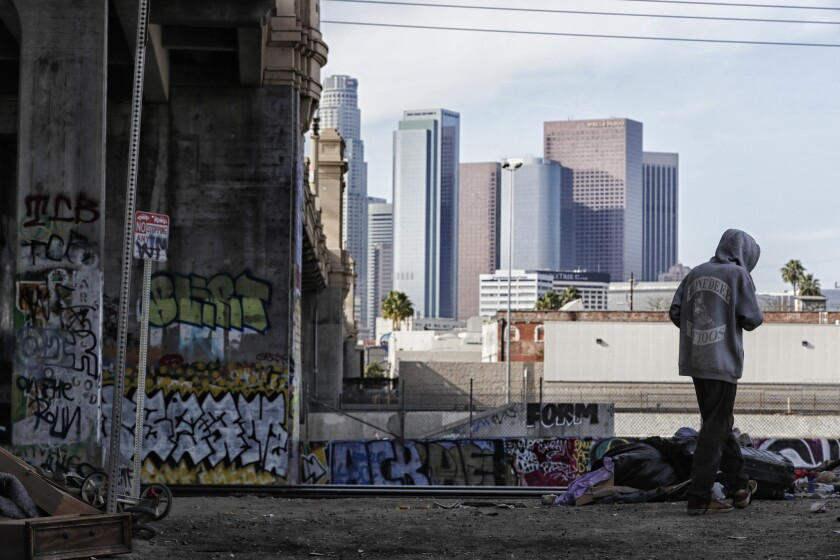 LOS ANGELES, CA, SUNDAY, JANUARY 7, 2018 - People living under the Fourth St. Bridge a day before ra
