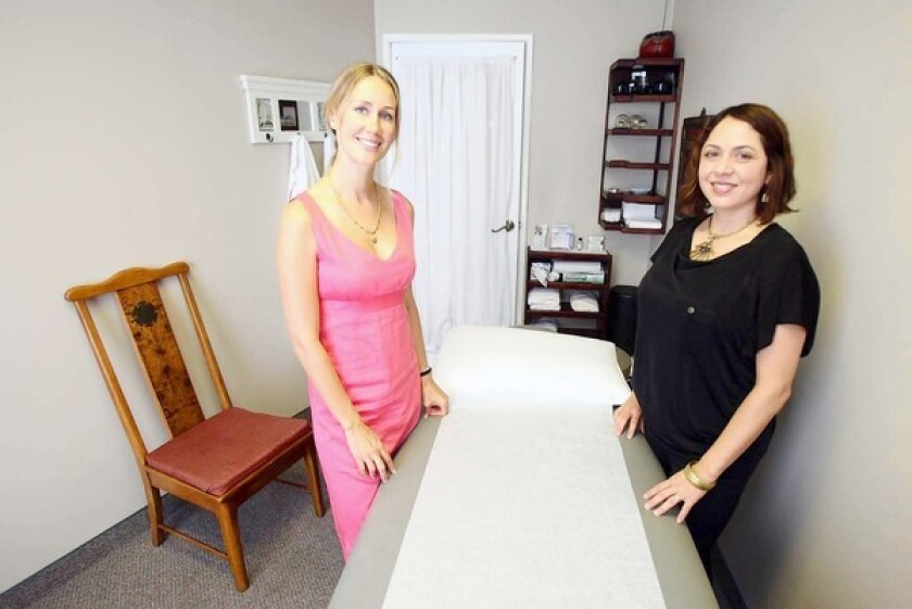 Angela Sinnett, left, and Andrea Allerton of Magnolia Acupuncture in Costa Mesa.