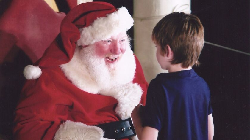 Santa talks to boy in Balboa Park