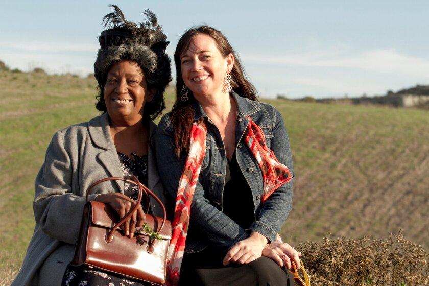 Sylvia M'Lafi Thompson (left) with Kristianne Kurner of New Village Arts. Daren Scott