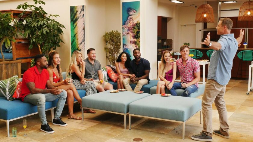 """The cast of USA Network's reboot of """"Temptation Island"""" is greeted by returning host Mark L. Walberg."""