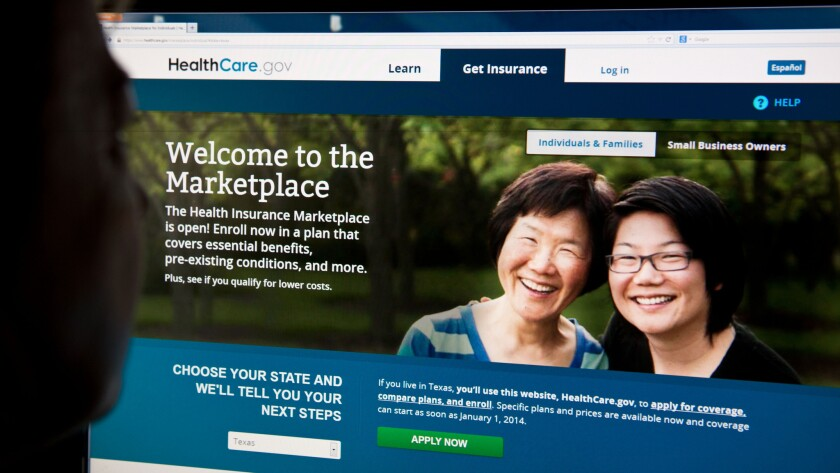 A woman looking at the HealthCare.gov insurance exchange internet site in Washington, D.C.