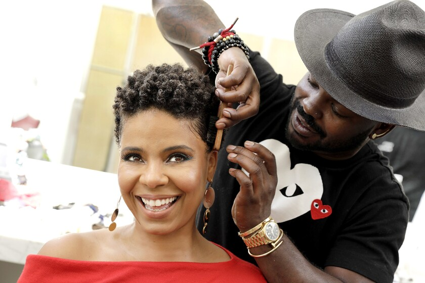 """Sanaa Lathan gets ready for a photo shoot promoting """"Nappily Ever After"""" with help from celebrity stylist Larry Sims."""