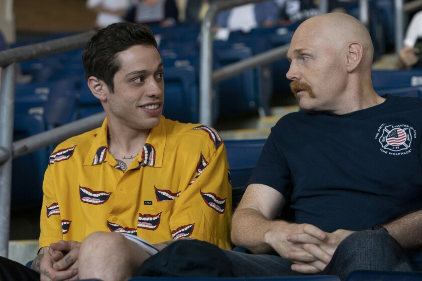 """Scott Carlin (Pete Davidson) and Ray Bishop (Bill Burr) in """"The King of Staten Island,"""" directed by Judd Apatow."""