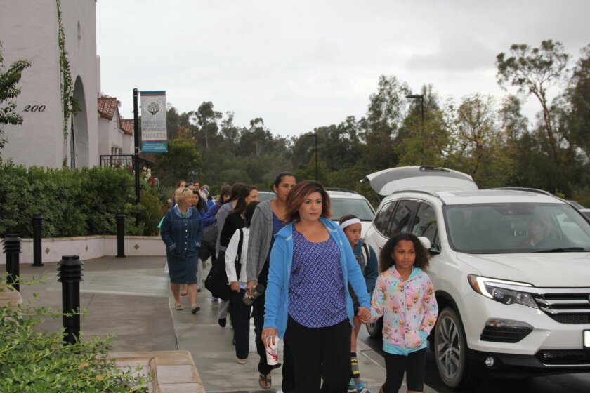 R. Roger Rowe teachers walk into school together in solidarity. Photo by Karen Billing