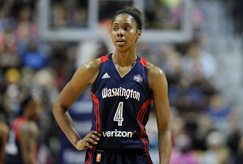 FILE - In this May 21, 2016, file photo, Washington Mystics' Tayler Hill watches during the second half of a WNBA basketball game against the Connecticut Sun in Uncasville, Conn. When Hill told Mike Thibault she was pregnant after her rookie season in the WNBA, the Mystics' coach and general manage
