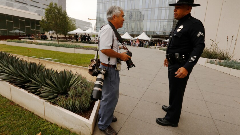 Associated Press photographer Nick Ut with an officer before a graduation ceremony at LAPD headquarters.