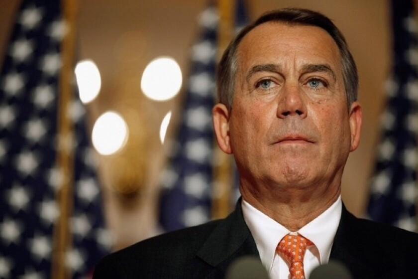 Speaker of the House John Boehner answers reporters' questions during a news conference on the payroll tax vote outside his office at the Capitol.