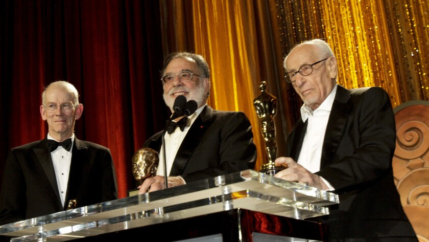 Film historian and preservationist Kevin Brownlow, left, with Francis Ford Coppola and Eli Wallach during the 2010 Governors Awards in Hollywood in 2010.