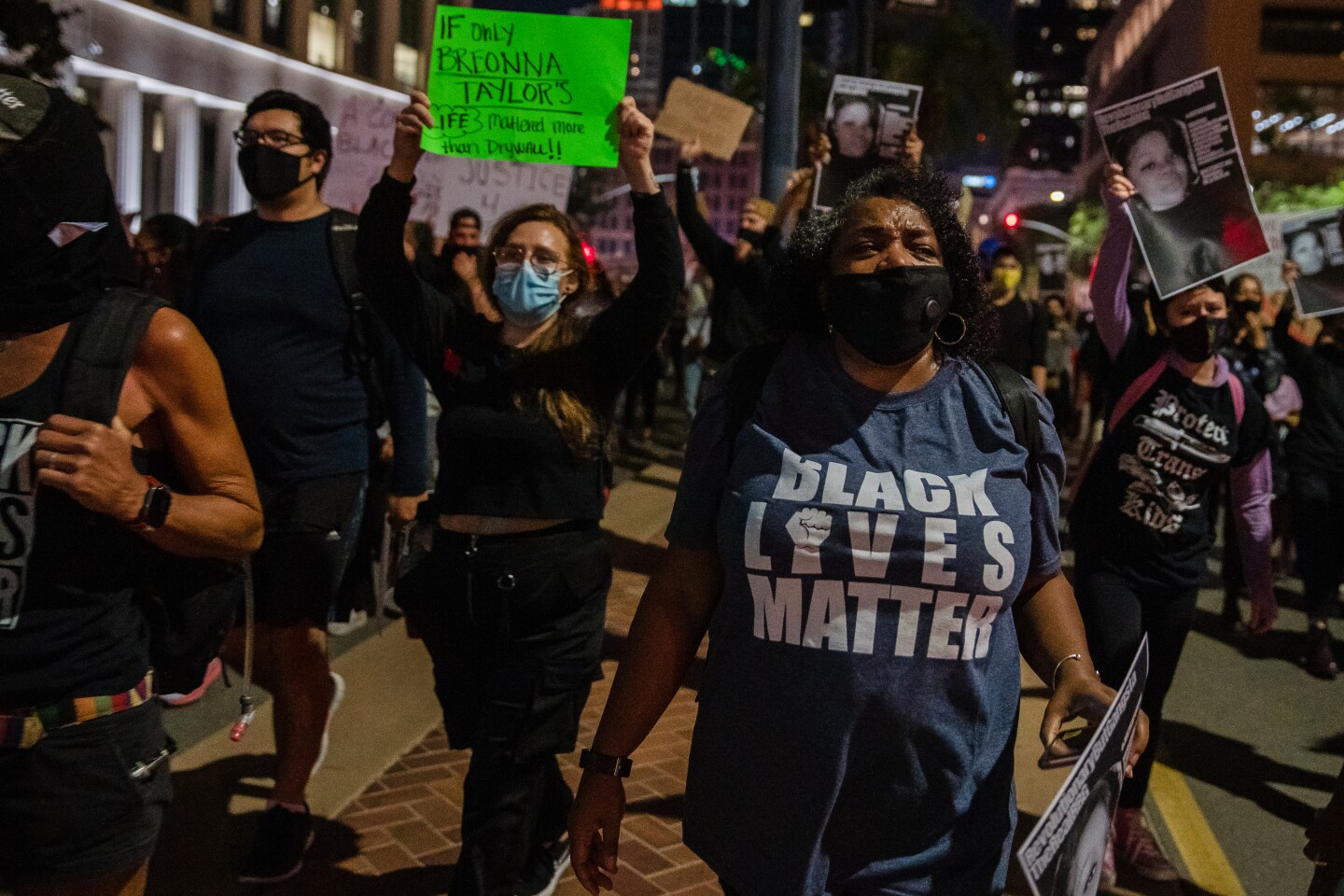 Protesters march through the streets of downtown San Diego
