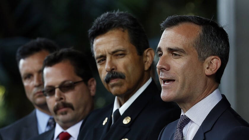 L.A. Mayor Eric Garcetti, right, stands next to city Fire Chief Ralph M. Terrazas.
