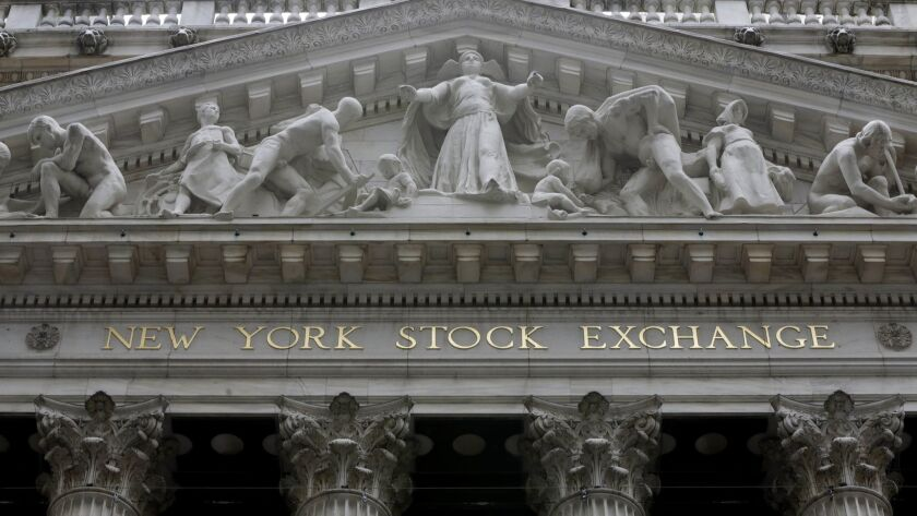 A late-in-the-session rally pulled the Dow Jones industrial average back from a 611-point loss Thursday.