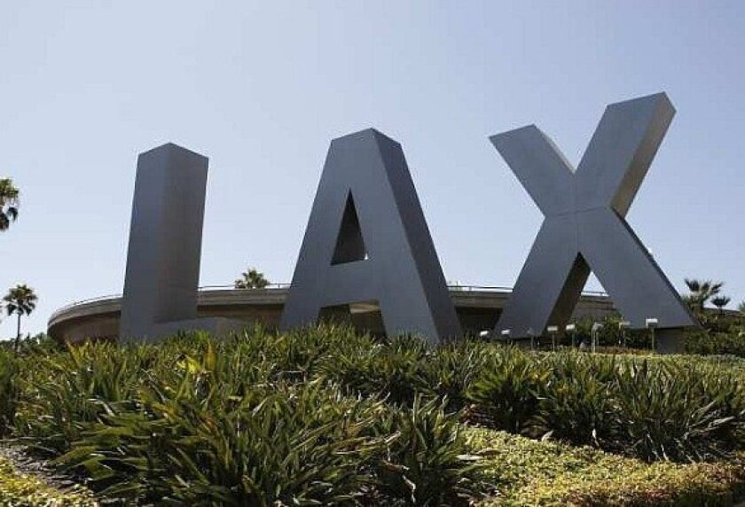 """Large """"L-A-X"""" letters on grass."""
