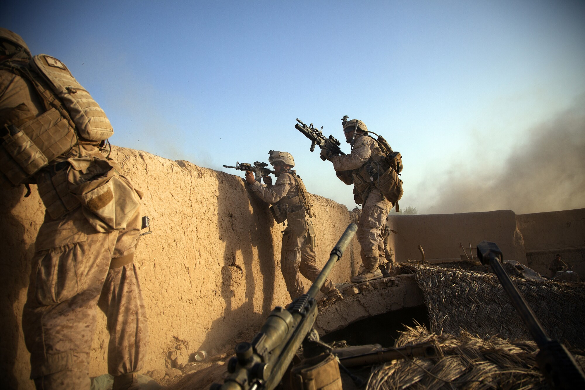 Marines from the 2nd Battalion 5th Marine Regiment return fire on the enemy