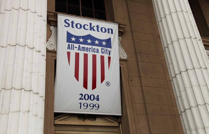 A banner proclaiming Stockton as an All-America city hangs from city hall in Stockton, Calif.