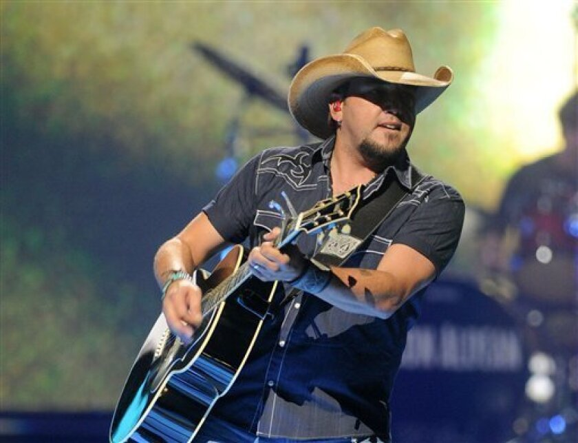 FILE - This Sept. 21, 2012 photo shows country singer Jason Aldean performing at the iHeart Radio Music Festival at the MGM Grand Arena in Las Vegas. Aldean is one of the top artists that has helped KSON-FM to the top of the San Diego radio ratings. (Photo by Eric Reed/Invision/AP, file)