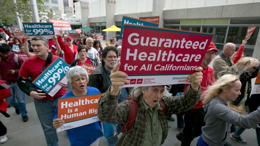 Supporters of single-payer health care march to the Capitol, Wednesday, April 26, 2017, in Sacrament