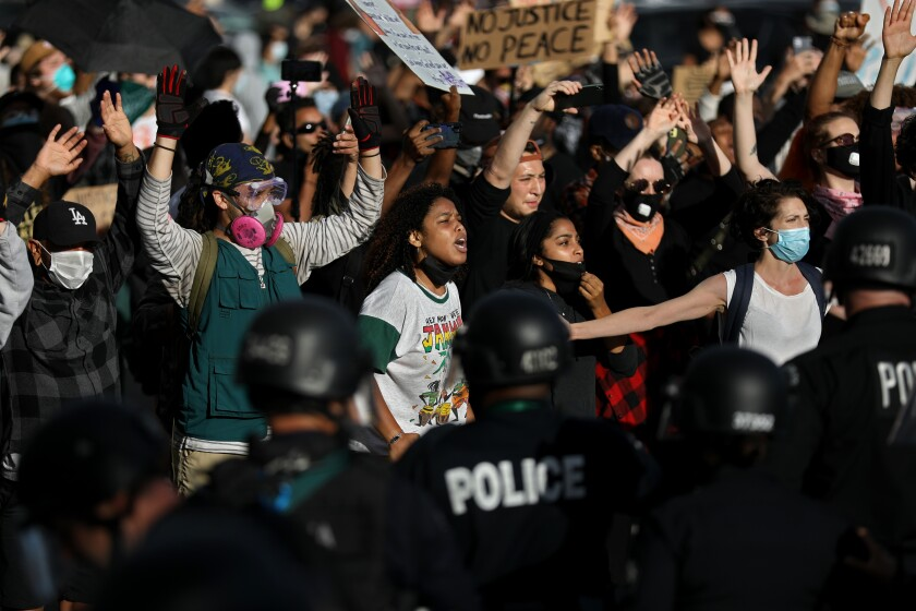 Protesters demonstrate May 30 in Los Angeles in response to the death of George Floyd in Minneapolis.