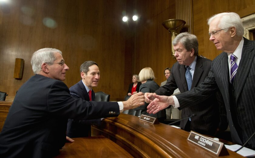 NIH National Institute of Allergy and Infectious Diseases Director Anthony Fauci, left, and CDC Director Thomas Frieden, second from left, shake hands with Senate Labor, Health and Human Services, Education, and Related Agencies subcommittee Chairman Roy Blunt, R-Mo., and subcommittee member Sen. T