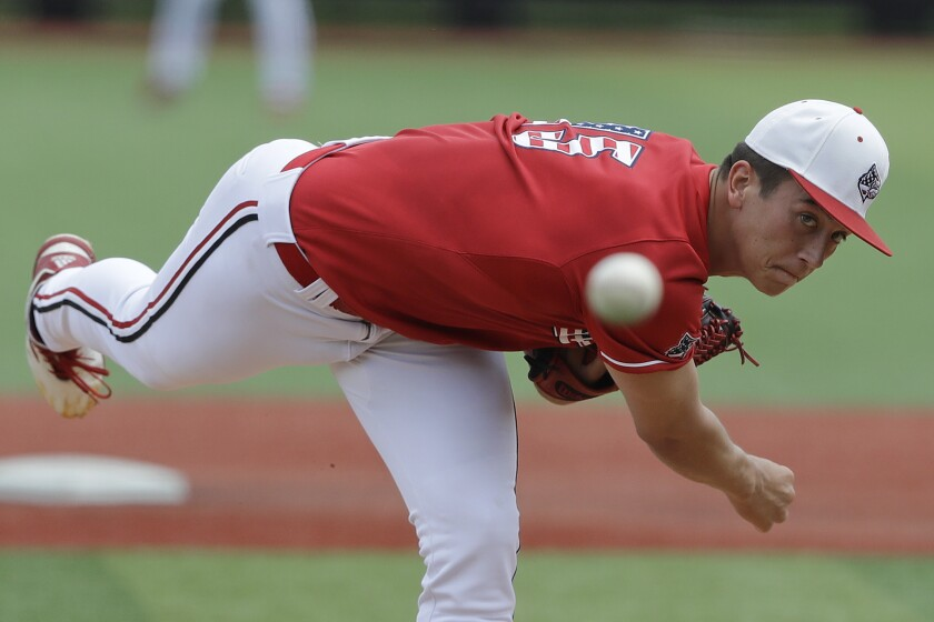 Louisville's Bobby Miller pitches against East Carolina in an NCAA super regional game in Louisville, Ky., on June 8, 2019.