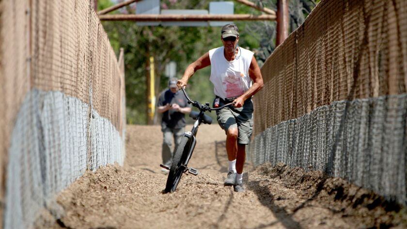 Burbank resident and cycling enthusiast Doug Weiskopf is opposed to the bridge being off-limits to p