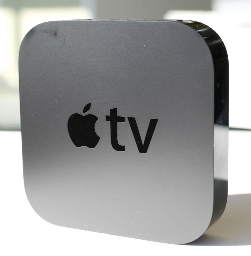 A report Wednesday said new code in Apple's software seems to indicate the tech company will bring Siri to the next version of Apple TV.
