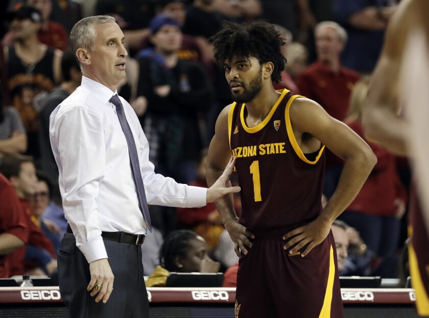 Arizona State and coach Bobby Hurley (left) will host SDSU in December as part of a two-year series, with a game at Viejas Arena in 2021-22.