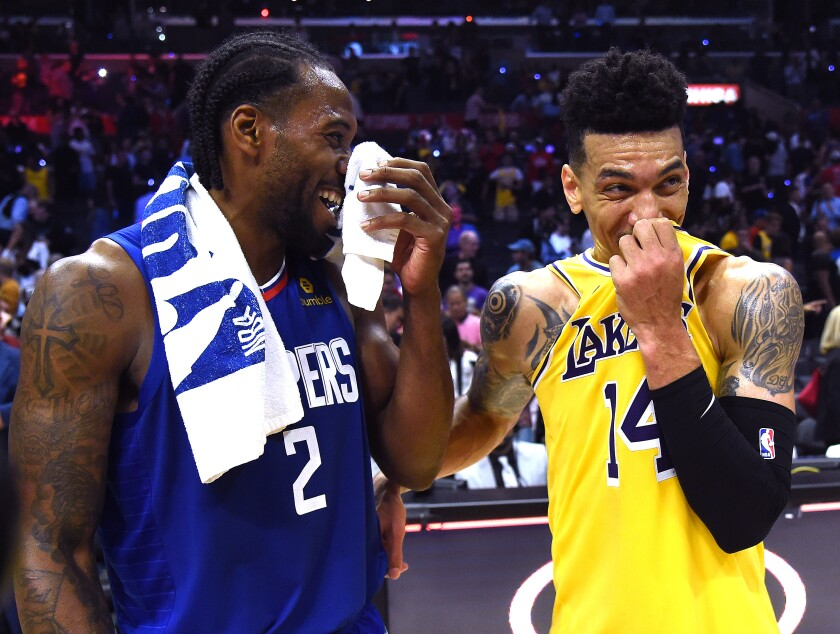 Clippers star Kawhi Leonard Lakers guard Danny Green share a laugh.