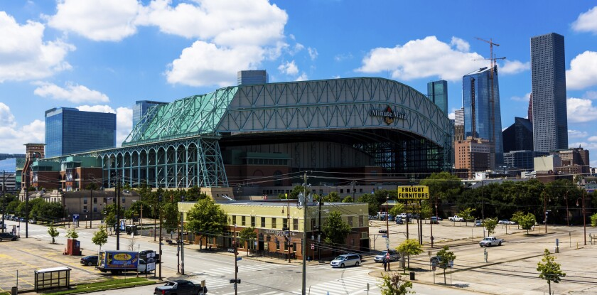FILE - This Sept. 11, 2016 file photo shows a wide angle view of Minute Maid Park in downtown Houston. Major League Baseball has expanded its investigation into the Houston Astros after The Athletic website reported the team stole signs during home games in 2017 by using a camera positioned in center field. The report Tuesday, Nov. 12, 2019 quoted pitcher Mike Fiers, who played for the Astros that season, and three other unidentified people with the club. The Astros won the World Series that year — two sources told The Athletic that Houston used the system into the playoffs while another source said it ended before the postseason. (AP Photo/Juan DeLeon, file)