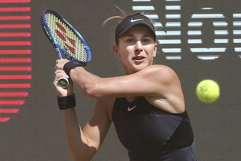 Switzerland's Belinda Bencic plays a backhand against French Alize Cornet in the seminfinal of the women's tennis tournament in Belin, Germany, Saturday, June 19, 2021. (Wolfgang Kumm/dpa via AP)