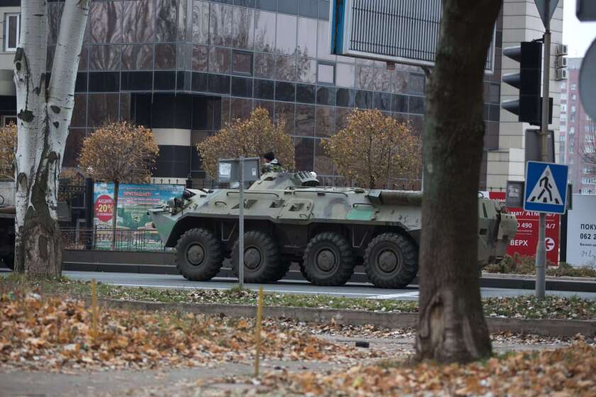 An armored personnel carrier rolls through Donetsk city on Wednesday, one of dozens of combat vehicles that NATO reports have flooded into the eastern Ukraine conflict area from Russia over the past few days.