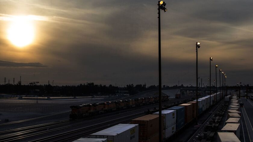 Freight-moving industries have long argued that formal regulations by the region's air quality district would stifle job growth. Above, a smoggy day over the San Bernardino rail yard.