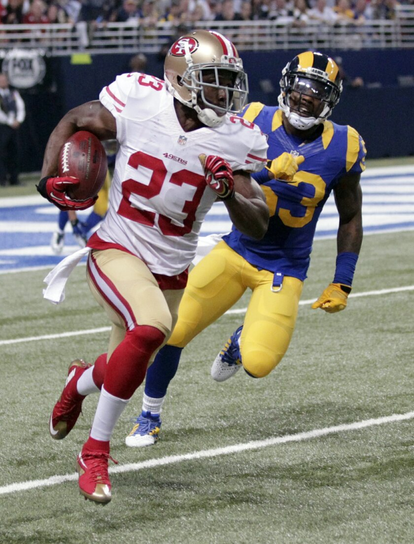 San Francisco 49ers running back Reggie Bush (23) runs with the ball as St. Louis Rams linebacker Daren Bates pursues during the first quarter of an NFL football game Sunday, Nov. 1, 2015, in St. Louis. (AP Photo/Tom Gannam)