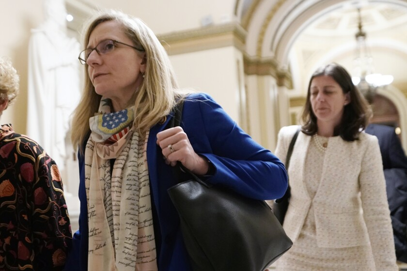 FILE - In this Dec. 18, 2019 file photo, Rep Abigail Spanberger D-Va., left, and Rep Elaine Luria. D-Va., walk at the Capitol in Washington. The U.S. Chamber of Commerce has decided to endorse 23 freshmen House Democrats in this fall's elections. The move represents a gesture of bipartisanship by the nation's largest business organization, which has long leaned strongly toward Republicans. (AP Photo/J. Scott Applewhite)