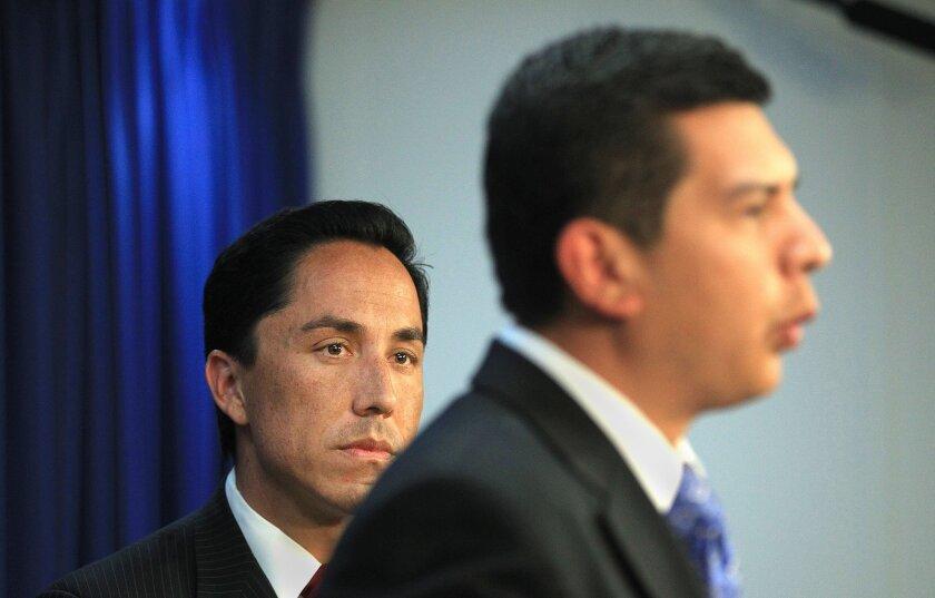 Councilmen David Alvarez, right, and Todd Gloria