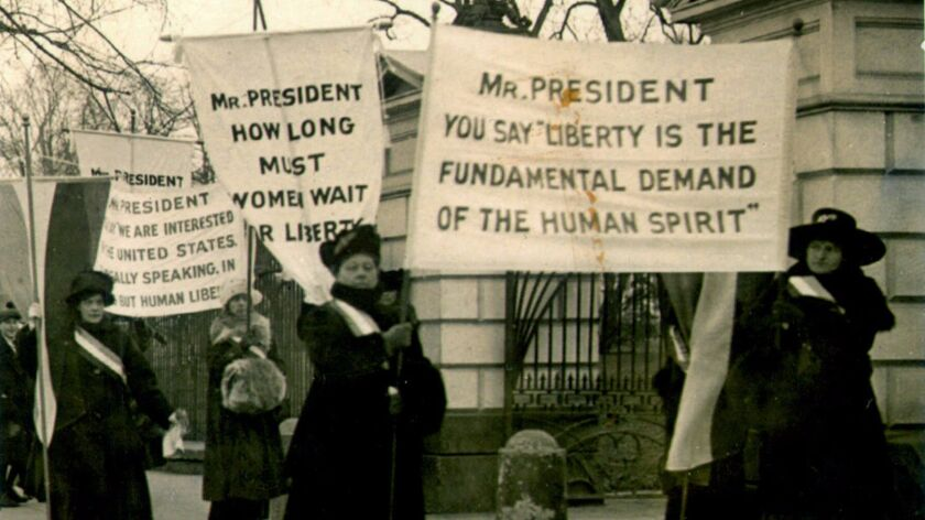 FILE––A circa 1918 file photo of women demonstrating at the White House demanding voting rights. The