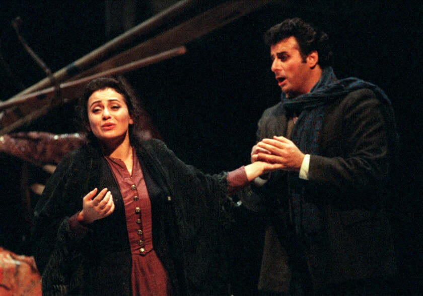 "Leontina Vaduva and Marcello Giordani in Opera Pacific's production of ""La Boheme"" at the Orange County Performing Arts Center in Costa Mesa in 1998."