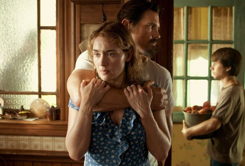 """Things might look tense between Kate Winslet and Josh Brolin in """"Labor Day."""" But those peaches young Gattlin Griffith is holding in the background will provide sweet relief."""
