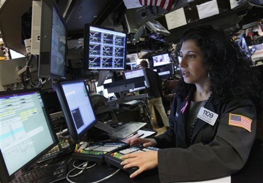 Specialist Tina Vlitas works at her post on the floor of the New York Stock Exchange Wednesday, Oct. 6, 2010. (AP Photo/Richard Drew)
